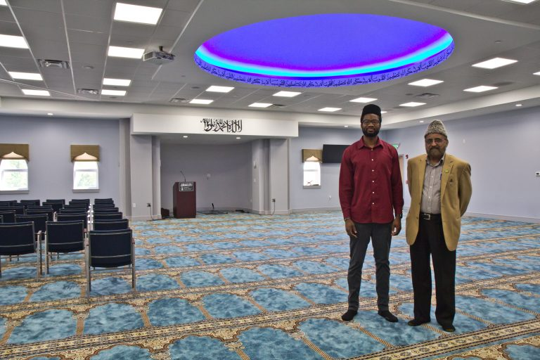 Imam Abdullah Dibba (left) and Mujeeb Choudhary (right) in the men's prayer room at the Bait-ul-Aafiyat Mosque in Philadelphia. (Kimberly Paynter/WHYY)