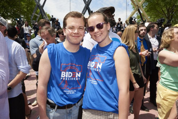 Jarod Watson and Maisie Macmullan, two Drexel students who live in Philadelphia, attend Former Vice President Joe Biden's presidential kickoff campaign rally at Eakins Oval in Philadelphia, Pa. (Natalie Piserchio for WHYY)