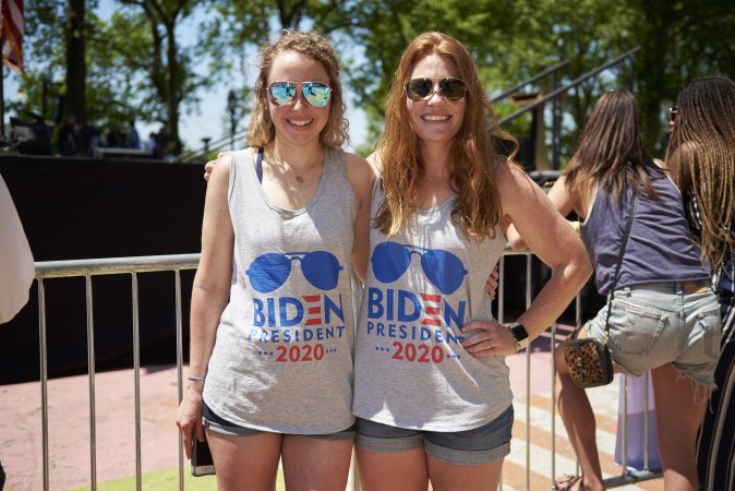 Leah Heyel and Sara Chandler, both of Wilmington, Del., attend Former Vice President Joe Biden presidential kickoff campaign rally at Eakins Oval in Philadelphia, Pa. They both think that Joe Biden is the country's best option in order to bring back our moral compass. (Natalie Piserchio for WHYY)