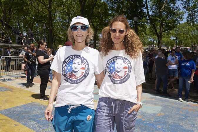 Wendy Collins and Dr. Debbie Kutner, both of Philadelphia Pa., attend the Biden rally in support of Reality Winner, Trump's first political prisoner. (Natalie Piserchio for WHYY)