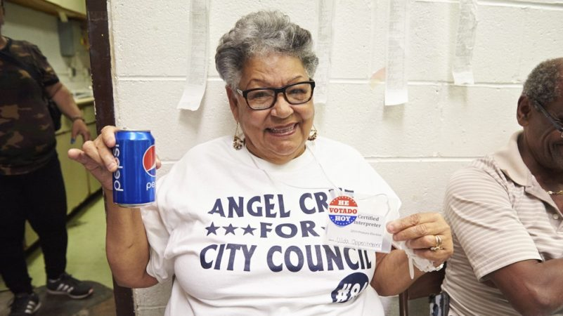 Nilda Oppenheimer, a poll worker and certified interpreter for the city of Philadelphia, enjoys a Pepsi after the 2019 Philadelphia Primary election polls close. (Natalie Piserchio for WHYY)