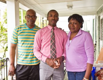 William Bess, 19, (center) with his mother and father on their porch in East Mt. Airy. (Kimberly Paynter/WHYY)