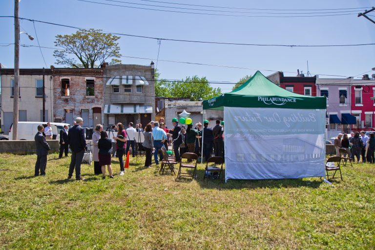 Philabundance employees and government officials ceremonially break ground at the site of a new community kitchen on north 10th Street. (Kimberly Paynter/WHYY)