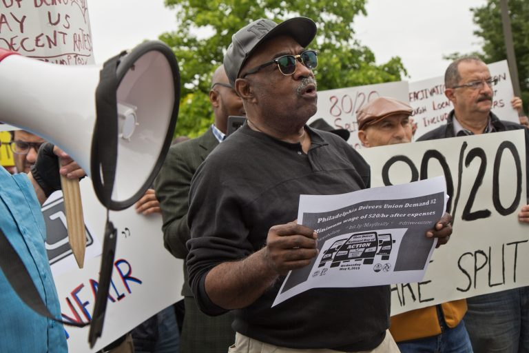 Driver Kevin Myers protests outside Uber's Philadelphia headquarters Wednesday. (Kimberly Paynter/WHYY)