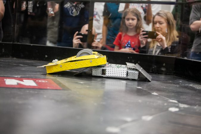 Pre-Swiss Cheese, a robot fielded by Upper Bucks County Technical School competes against MaST Community Charter School's robot Mcnasty during the Liberty Bots competiton Saturday at Montgomery County Community College. (Brad Larrison for WHYY)