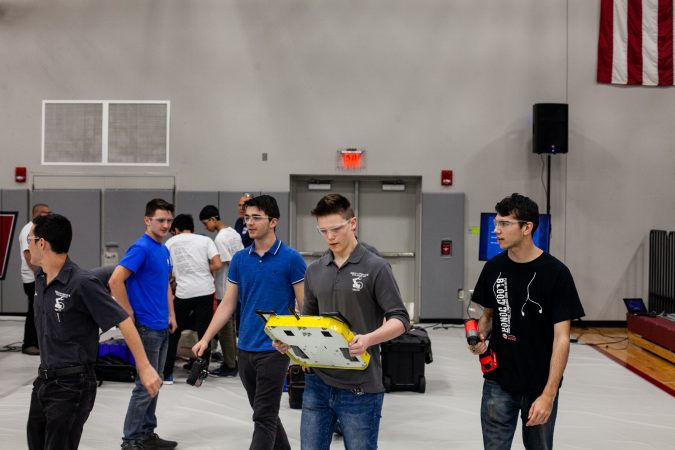 Students from Upper Bucks County Technical School carry their robot Pre-Swiss Cheese to the