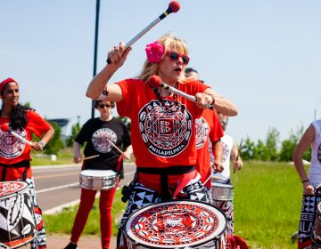Members of the Afro-Brazilian band Batala perform at the Navy Yard during the Anti-Defamation League's Walk Against Hate Sunday morning. (Brad Larrison for WHYY)