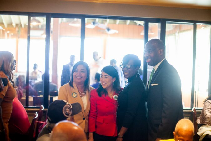 From left, City Councilwomen Maria Quiñones-Sánchez, Helen Gym, Cherelle Parker and Councilman Derek Green are pictured at Relish Tuesday afternoon during the 2019 primary election. (Brad Larrison for WHYY)