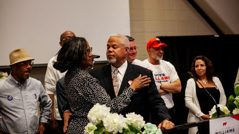 Democratic mayoral candidate Anthony Hardy Williams hugs his wife Shari after addressing supporters and conceding to incumbent Mayor Jim Kenney Tuesday evening. (Brad Larrison for WHYY)