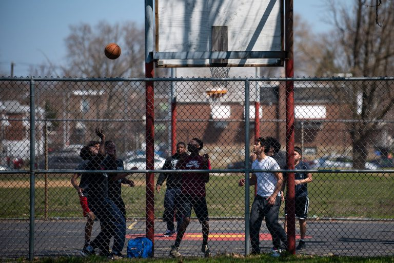 A group of boys play a game of basketball at Vogt park in Mayfair on Saturday, April 6, 2019. (Kriston Jae Bethel for WHYY)