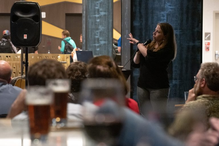 Jessica Choppin Roney, associate professor of history at Temple University, lectures on colonial-era Philadelphia politics at the Cambria Hotel during the city's first Profs and Pints event. (Kriston Jae Bethel for WHYY)