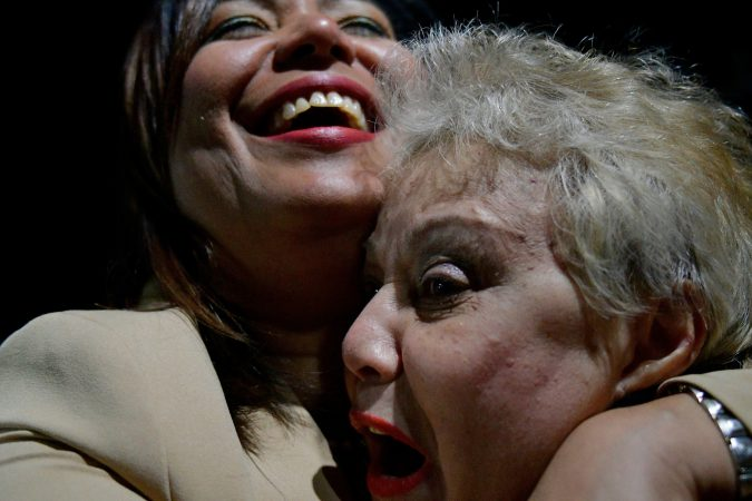 Bienvebita Neris receives a hug from her daughter Maria Quiñones-Sanchez as the councilwomen celebrates the victory over state Rep. Ángel Cruz in the race in the 7th Councilmanic district. (Bastiaan Slabbers for WHYY)