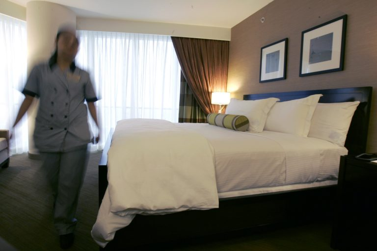 A maid walks through a bedroom in a suite in Atlantic City, N.J. (Mike Derer/AP Photo, file)