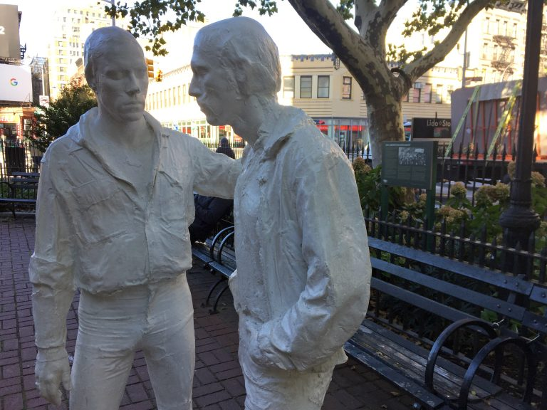 This Oct. 20, 2017 photo shows two figures that are part of the Gay Liberation Monument in Christopher Park across from the Stonewall Inn in Greenwich Village in New York. Riots took place at the Stonewall Inn after a police raid in 1969, and the park was declared a U.S. national monument in 2016 to honor the birthplace of the LGBT rights movement. (AP Photo/Beth J. Harpaz)