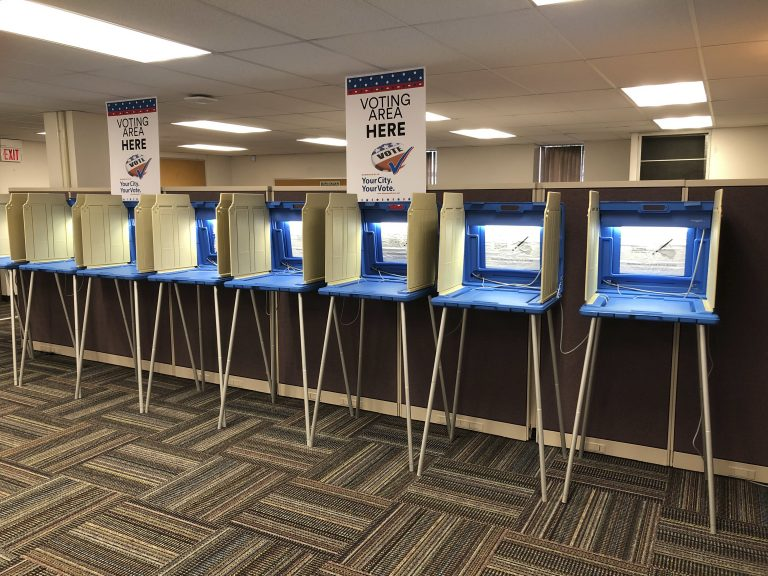 Voting booths stand ready in this Sept. 20, 2018 photo. Election officials and federal cybersecurity agents are touting improved collaboration aimed at confronting and deterring efforts to tamper with elections. (Steve Karnowski/AP Photo)