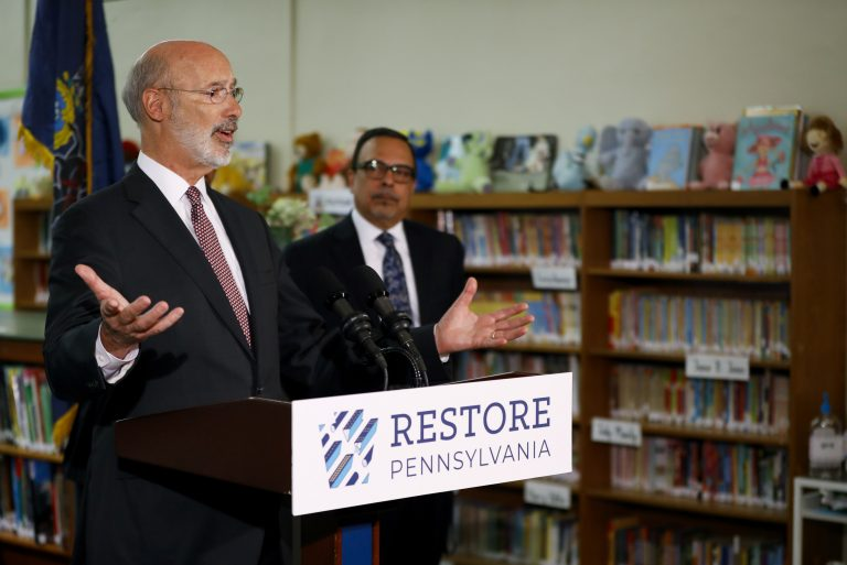 Pennsylvania Gov. Tom Wolf, left, speaks as John H. Taggart School Principal Nelson R. Reyes looks on during a news conference at the school's library, Thursday, March 21, 2019, in Philadelphia. Wolf discussed his infrastructure package, Restore Pennsylvania, to help remediate contaminants from Pennsylvania schools. (Matt Slocum/AP Photo)