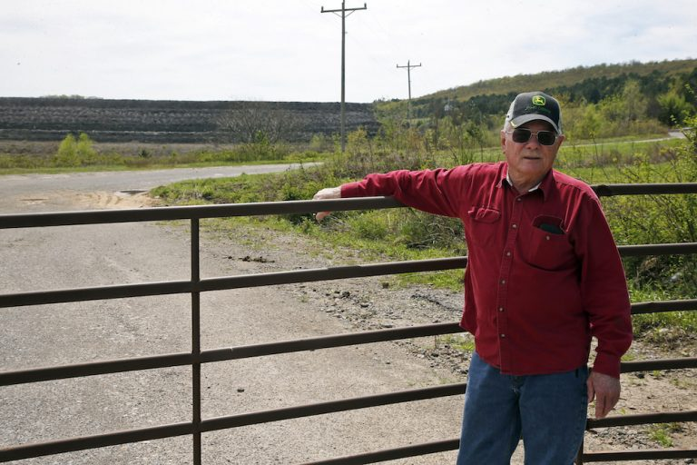 Tim Tanksley, one of the few local people still fighting after years of trying to convince Oklahoma lawmakers to crack down on the coal ash dumping, stands outside a dump site Monday, April 8, 2019, in Bokoshe, Okla.(Sue Ogrocki/AP Photo)
