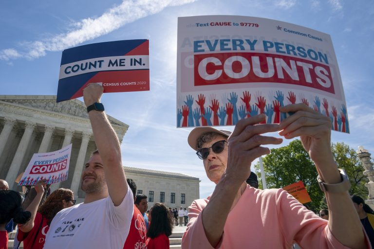 Immigration activists rally outside the Supreme Court as the justices hear arguments over the Trump administration's plan to ask about citizenship on the 2020 census. (J. Scott Applewhite/AP Photo)