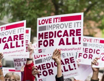 Members of National Nurses United union members wave 'Medicare for All' signs during a rally in front of the Pharmaceutical Research and Manufacturers of America in Washington calling for 'Medicare for All' on Monday, April 29, 2019. (Photo By Bill Clark/CQ Roll Call via AP Images)
