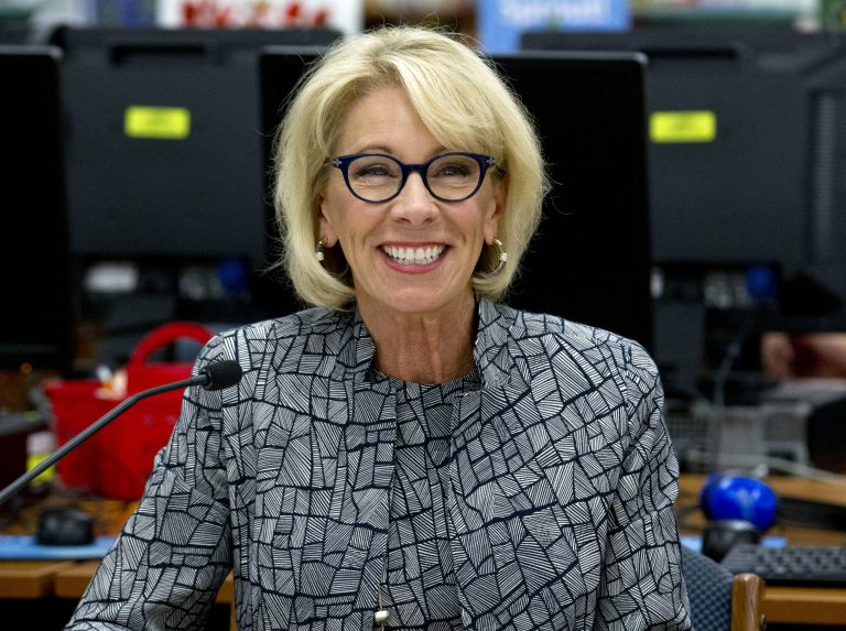 In this May 31, 2018, file photo, Education Secretary Betsy DeVos speaks during a visit of the Federal School Safety Commission at Hebron Harman Elementary School in Hanover, Md. Education, it's safe to say, is not President Donald Trump's top priority. Instead, he entrusts that realm to Education Secretary Betsy DeVos, who after two years has emerged as one of the most polarizing figures in the Cabinet but also one of its most enduring members. (Jose Luis Magana/AP Photo)