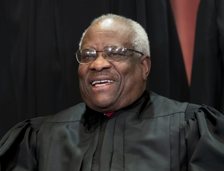 In this Nov. 30, 2018, file photo, Supreme Court Associate Justice Clarence Thomas, appointed by President George H. W. Bush, sits with fellow Supreme Court justices for a group portrait at the Supreme Court Building in Washington. Thomas is now the longest-serving member of a court that has recently gotten more conservative, putting him in a unique and potentially powerful position, and he's said he isn't going away anytime soon. (J. Scott Applewhite/AP Photo, File)