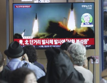 People watch a TV showing a file footage of North Korea's missile launch during a news program at the Seoul Railway Station in Seoul, South Korea, Saturday, May 4, 2019. North Korea on Saturday fired several unidentified short-range projectiles into the sea off its eastern coast, the South Korean Joint Chiefs of Staff said. (Ahn Young-joon/AP Photo)
