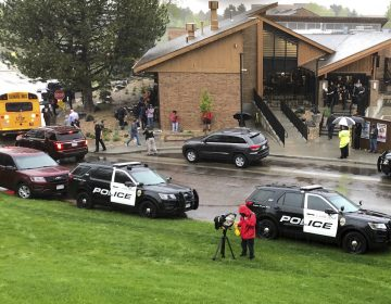Police and others are seen outside STEM School Highlands Ranch, a charter middle school in the Denver suburb of Highlands Ranch, Colo., after a shooting Tuesday, May 7, 2019. Authorities said several people were injured and a few suspects were in custody. (David Zalubowski/AP Photo)