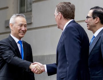 Treasury Secretary Steve Mnuchin, (right), and United States Trade Representative Robert Lighthizer, (center), greet Chinese Vice Premier Liu He as he arrives at the Office of the United States Trade Representative in Washington, Friday, May 10, 2019 for trade talks between the United States and China. (Andrew Harnik/AP Photo)