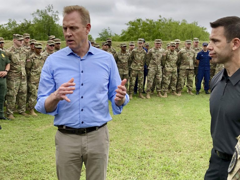Acting Defense Secretary Patrick Shanahan, (left), speaks with troops near McAllen, Texas, about the military's role in support of the Department of Homeland Security's effort to secure the Southwest border. At right is Kevin McAleenan, acting DHS secretary. (Robert Burns/AP Photo)