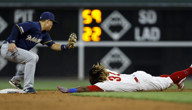 Philadelphia Phillies' Odubel Herrera, right, steals second base past Milwaukee Brewers second baseman Keston Hiura during the second inning of a baseball game, Tuesday, May 14, 2019, in Philadelphia. (AP Photo/Matt Slocum)