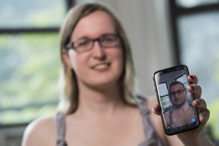 In this Wednesday, May 15, 2019, photo, Bailey Coffman shows her photo as a man in the Snapchat app during an interview in New York. Snapchat's new photo filter that allows users to change into a man or woman with the tap of a finger isn't necessarily fun and games for transgender people. But some others see the potential for such tools to lead to self-discovery among people struggling with their gender identity. (Mary Altaffer/AP Photo)