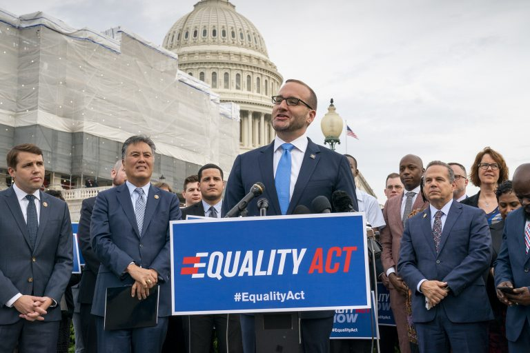 Chad Griffin, president of the Human Rights Campaign, flanked by Rep. Mark Takano, D-Calif., (left), and Rep. David Cicilline, D-R.I., speaks to advocates for LGBTQ rights as they rally before a vote in the House on the 'Equality Act of 2019,' sweeping anti-discrimination legislation that would extend civil rights protections to LGBT people by prohibiting discrimination based on sexual orientation or gender identity, at the Capitol in Washington, Friday, May 17, 2019. Cicilline is the chief sponsor of the bill to protect LGBTQ rights. (J. Scott Applewhite/AP Photo)