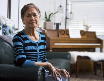 Normita Lim poses for a photograph at her home in Concord, Calif. Lim did not receive back pay from her former employer, Publico, who paid her $2 an hour. (James Tensuan/Reveal via AP)