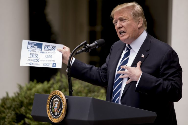 President Donald Trump holds up a stat sheet having to do with the Mueller Report as he speaks in the Rose Garden at the White House in Washington, Wednesday, May 22, 2019. (Andrew Harnik/AP Photo)