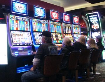 This Feb. 22, 2019 photo shows gamblers playing slot machines in the Golden Nugget casino in Atlantic City N.J. Figures released by New Jersey gambling regulators on May 22, 2019 show that gross operating profit for Atlantic City's nine casinos declined by nearly 30 percent in the first quarter of this year compared to the same period last year, when there were only seven casinos. (Wayne Parry/AP Photo)