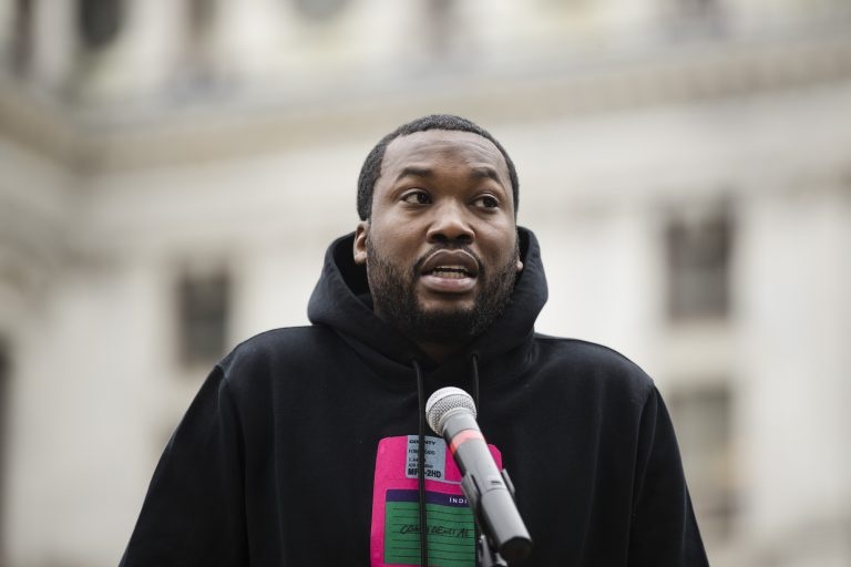 In this April 2, 2019, file photo, rapper Meek Mill speaks at a gathering in Philadelphia to push for drastic changes to Pennsylvania's probation system. Philadelphia's District Attorney's office wants a new trial with a new judge for rapper Meek Mill. Larry Krasner submitted the brief Wednesday, May 22, 2019. (Matt Rourke/AP Photo)