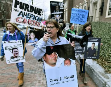 In this Friday, April 12, 2019, file photo, Cheryl Juaire of Marlborough, Mass., (center), leads protesters near the Arthur M. Sackler Museum at Harvard University in Cambridge, Mass. Juaire, whose son was addicted to opioids and died of a heroin overdose in 2011, led the demonstration by parents who've lost children in the addiction epidemic. They want the Sackler family name removed from the building at Harvard. In New York, there's a Sackler Wing at The Metropolitan Museum of Art and a Sackler Center for Arts Education at The Guggenheim. There's a Sackler Room at the National Gallery in London, a Sackler Wing of Oriental Antiquities at the Louvre. (Josh Reynolds/AP Photo)