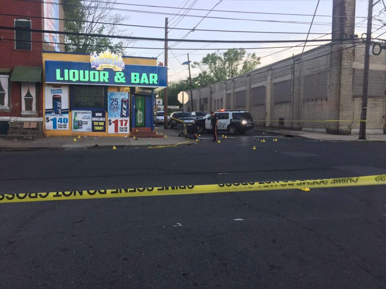 This photo provided by 3 CBS Philadelphia shows police canvasing the scene of a shooting in Trenton, N.J. on Saturday, May 25, 2019.  New Jersey police say 10 people have been wounded following a shooting at a Trenton bar.  Trenton police spokesman Capt. Stephen Varn said five men and five women were transported to local hospitals. He said one victim was critically wounded and taken into emergency surgery.  (3 CBS Philadelphia via AP)