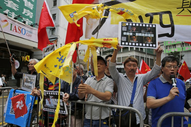 Pro-Beijing supporters destroy yellow umbrellas, used to mark protesting denouncing far-reaching Beijing control, during a demonstration in Hong Kong, Sunday, May 26, 2019. A vigil will be held on June 4 at the Victoria Park to mark the 30th anniversary of the military crackdown on the pro-democracy movement at Beijing's Tiananmen Square on June 4, 1989. (Kin Cheung/AP Photo)