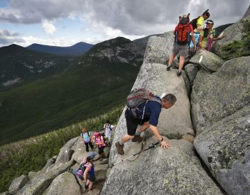 Day-hikers scramble over rocky boulders on the Appalachian Trail below the summit of Mt. Katahdin in Baxter State Park in Maine. (Robert F. Bukaty/AP Photo)