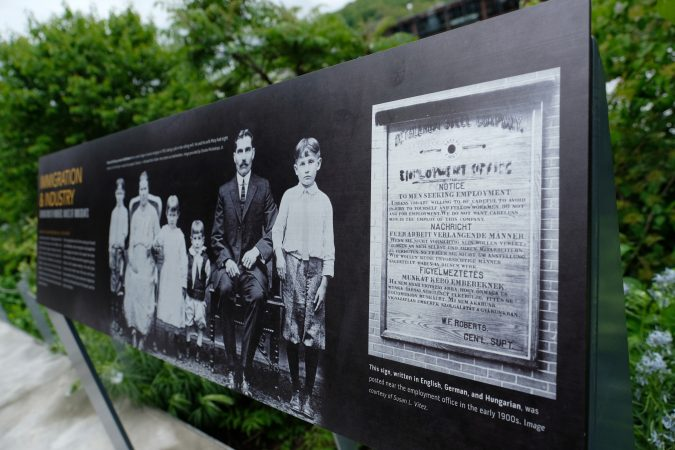 Educational placards show how Bethlehem Steel advertised to immigrants, attracting them to live in the city and get their citizenship while working at the plant. (Matt Smith for Keystone Crossroads)