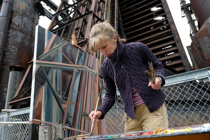 Artist Rachel Lussier works on a painting of the blast furnaces. (Matt Smith for Keystone Crossroads)