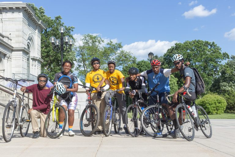 Members of the National Youth Bike Council pose at the Please Touch Museum before a group ride through Fairmount Park. (Angela Gervasi for WHYY)