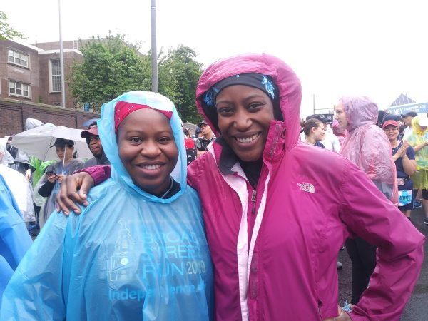 Lorpu Jones (left), came from New York City while her sister Shyloe Jones (right), came from Washington, D.C. to participate in the Broad Street Run together. (Ximena Conde/WHYY)