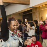 Robin Richardson cheers during an election party held at Reclaim Philadelphia and 215 People's Alliance headquarters on election night. (Jonathan Wilson for WHYY)