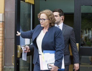 Karen Muir, (front), Becker's attorney, walked out of the Centre County Courthouse on Thursday, after the jury rendered a verdict for Becker. (Min Xian/WPSU)