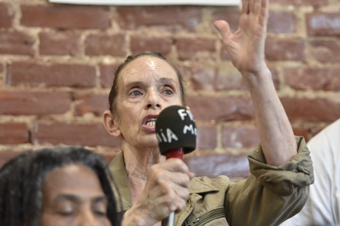 Sue Africa, who lost her son in the May 1985 bombing of the Osage Avenue MOVE house, responds to a question during the press conference. (Jonathan Wilson for WHYY)