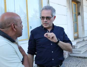 Philadelphia District Attorney Larry Krasner speaks to an outreach worker at a methadone distribution van in Lisbon, Portugal. (Courtesy of Fair and Just Prosecution)
