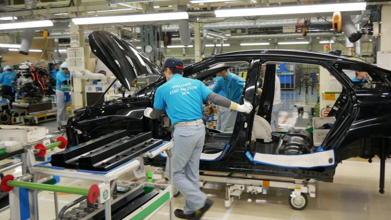 Workers push a partly assembled Mirai through the assembly line at Toyota's LFA Works in Aichi Prefecture, Japan. Since there are so few hydrogen fuel cell cars manufactured, all of them are assembled by hand. (Hiroo Saso)