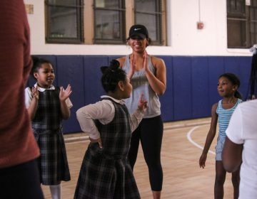 Students play a team-building game after taking a Zumba class with teacher Maya Sutton. The after school curriculum is organized by Philly Girls in Motion, a non-profit that aims to connect girls and active play. (Angela Gervasi for WHYY)